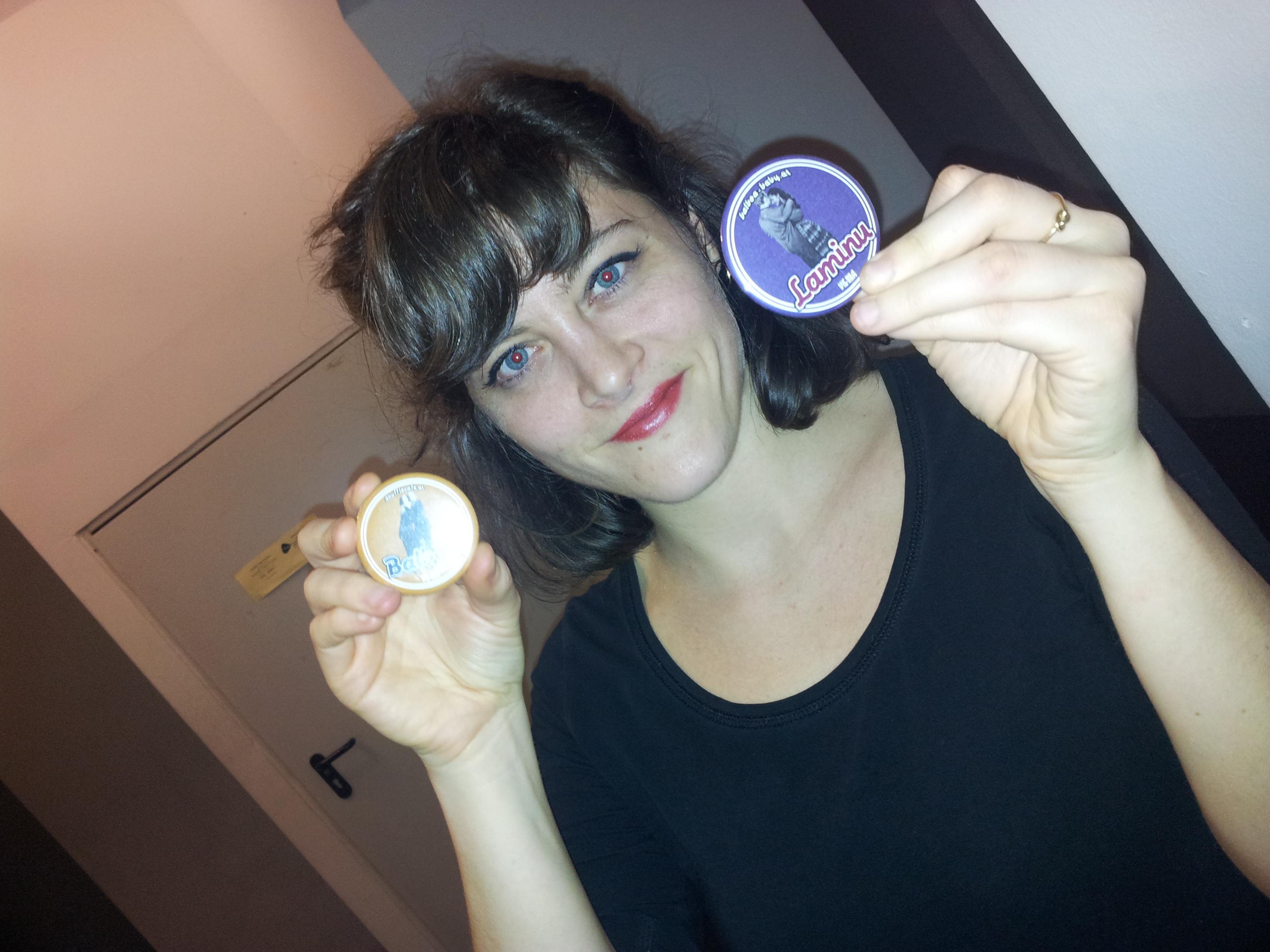 Simona holding Balboa and Laminu Badges
